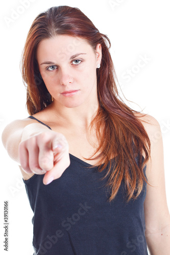 Young woman pointing at you