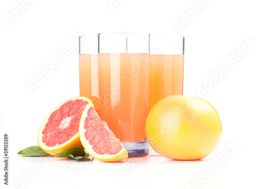 Glasses of pink grapefruit juice isolated on white