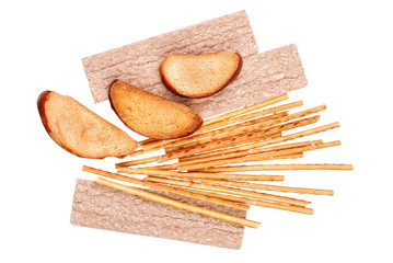 rusk and salted breadsticks isolated