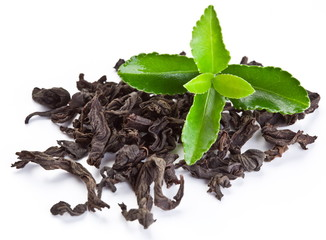 Heap of dry tea with green tea leaves.