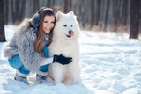 Fototapety Happy woman with dog in winter forest