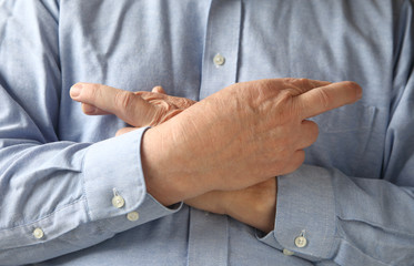 businessman crosses his fingers and hands