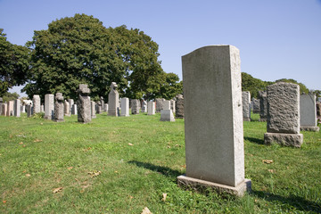 Blank gravestone in graveyard during the summer season
