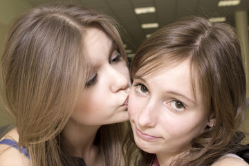 The girl kisses other girl