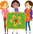Women Holding a Quilt