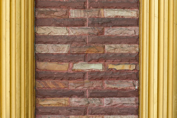 stone brick wall and golden pillars