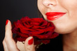 Girl with rose on red background.