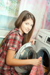 Teen girl loading the washing machine