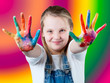 Children's hand in the paint on colorful background