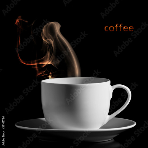 white cup with hot liquid and steam on black.