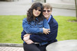 Interracial couple hugging outdoors