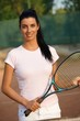 Beautiful female tennis player smiling