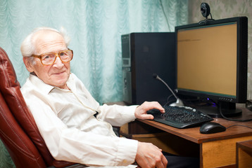 Pleased Old Man Near Computer
