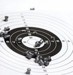 paper rifle target with bullet holes
