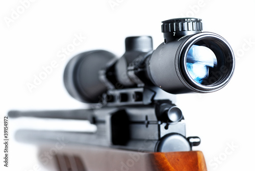 Closeup of a sniper rifle telescope glass lens isolated