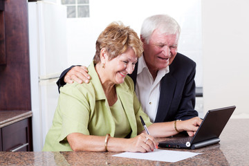 happy senior couple using internet banking checking bank balance