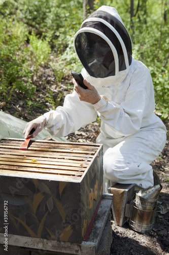 Beekeeper with cell phone