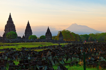 Prambanan hindu temple with Merapi volcano on the background