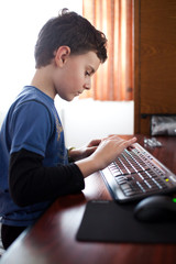 Boy typing on a keyboard