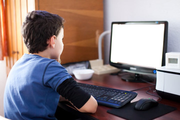 Boy reading on computer screen