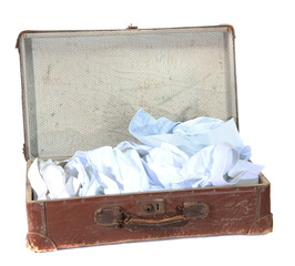 antiquarian brown suitcase with shirts