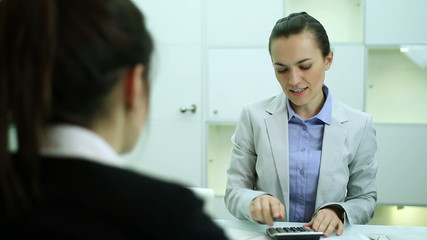 Female client in bank talking with business consultant