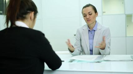 Boss communicate bad news to female worker