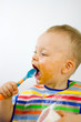 Infant Eating With Spoon Side On