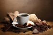 coffee cup and beans, cinnamon sticks, nuts and chocolate