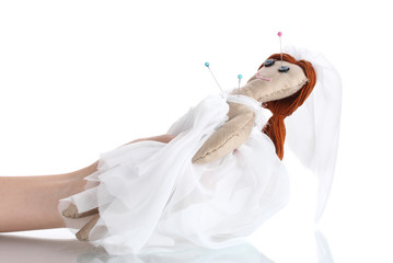 Voodoo doll girl-bride in the hands of women isolated on white