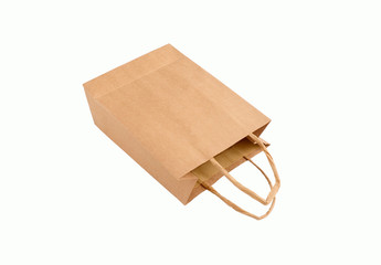 Recyclable brown paper bag laying on it's side, isolated