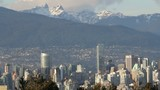 Vancouver Canada Skyline and Cityscape with Mountains