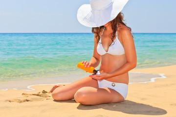 Young woman enjoy sun on the beach