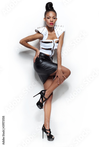 Portrait of sensual fashion girl isolated in studio.
