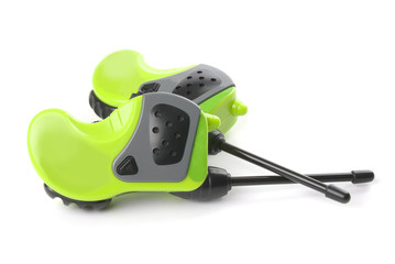 Two green walki talkies on a white background.