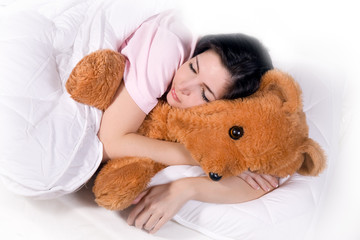 girl sleeping with teddy bear in bed