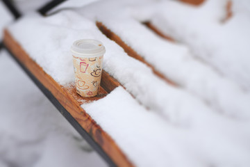 Hot coffee in cold winter day outdoors
