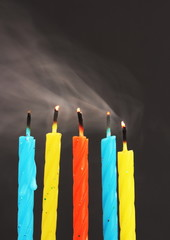 unlit candles with smoke