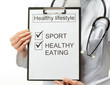 Doctor prescribing healthy lifestyle
