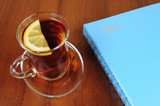 Cup of tea and notebook on table
