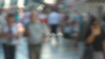 Blurred people in city walking street