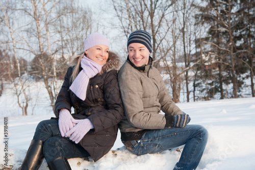 Man and woman sits on the wood