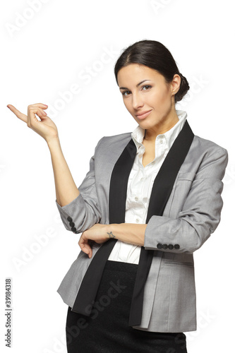 Young business woman pointing at white copy space