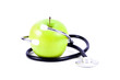Medical stethoscope and green apples.