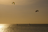 Kitesurfers silhouettes against sunset