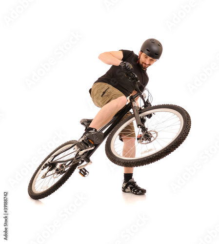 The bicyclist isolated on white.