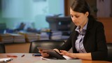 Attractive woman working with the tablet in the office