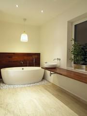 Freestanding bath in a modern bathroom interior