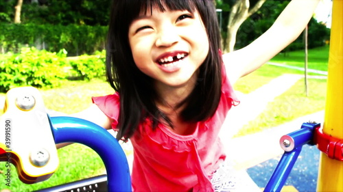 Asian girl playing at a playground