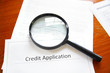 magnifying glass on a blank credit application